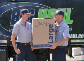 Two employees performing junk removal service