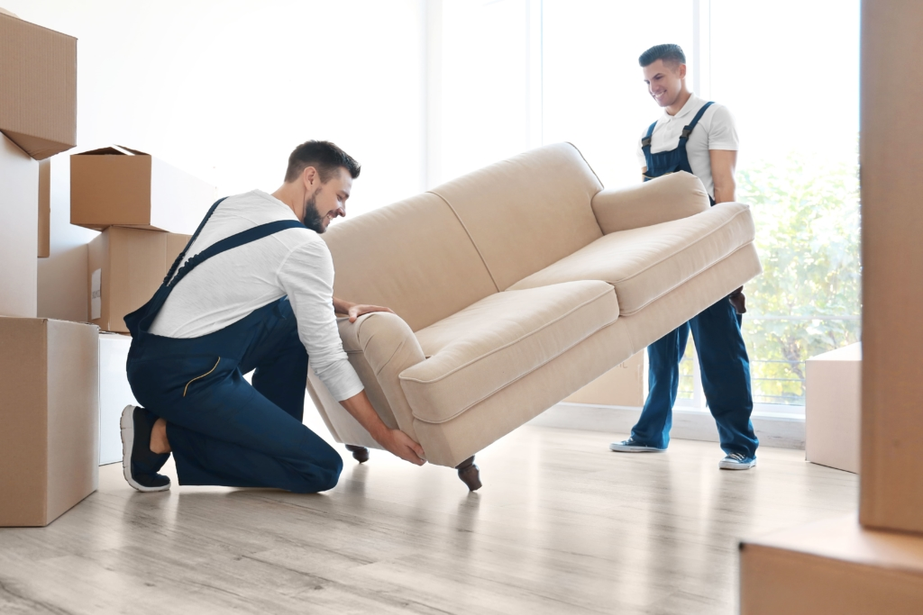 Two Big Haul team members performing furniture removal services